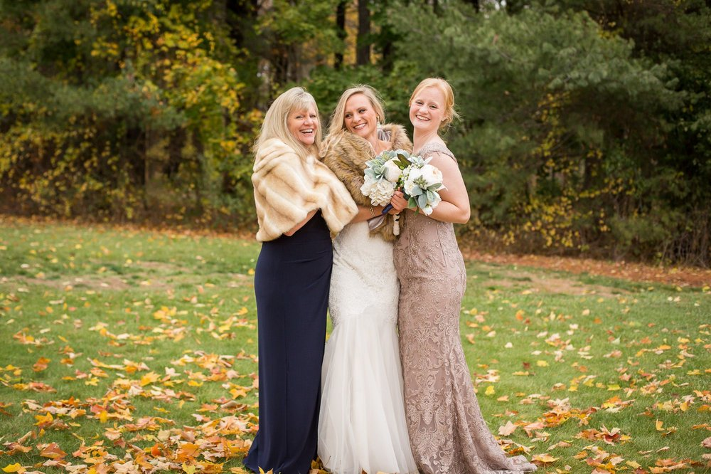 The well-known Green Cleaning Coach(mom) and her two daughters snuggling on this chilly fall day. Later I found out they were laughing because of some inside joke...nevertheless, I love this candid moment!