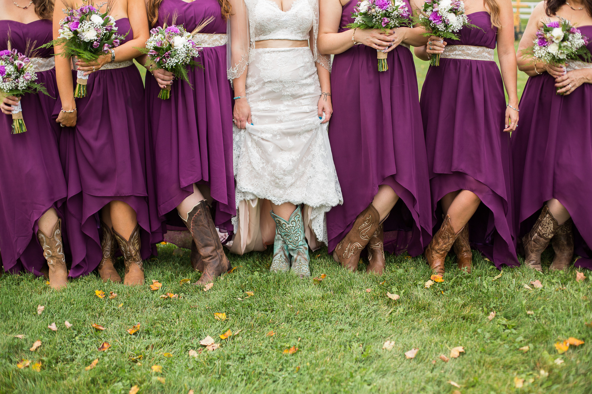 bride and bridesmaids with cowboy boots and plum purple dresses