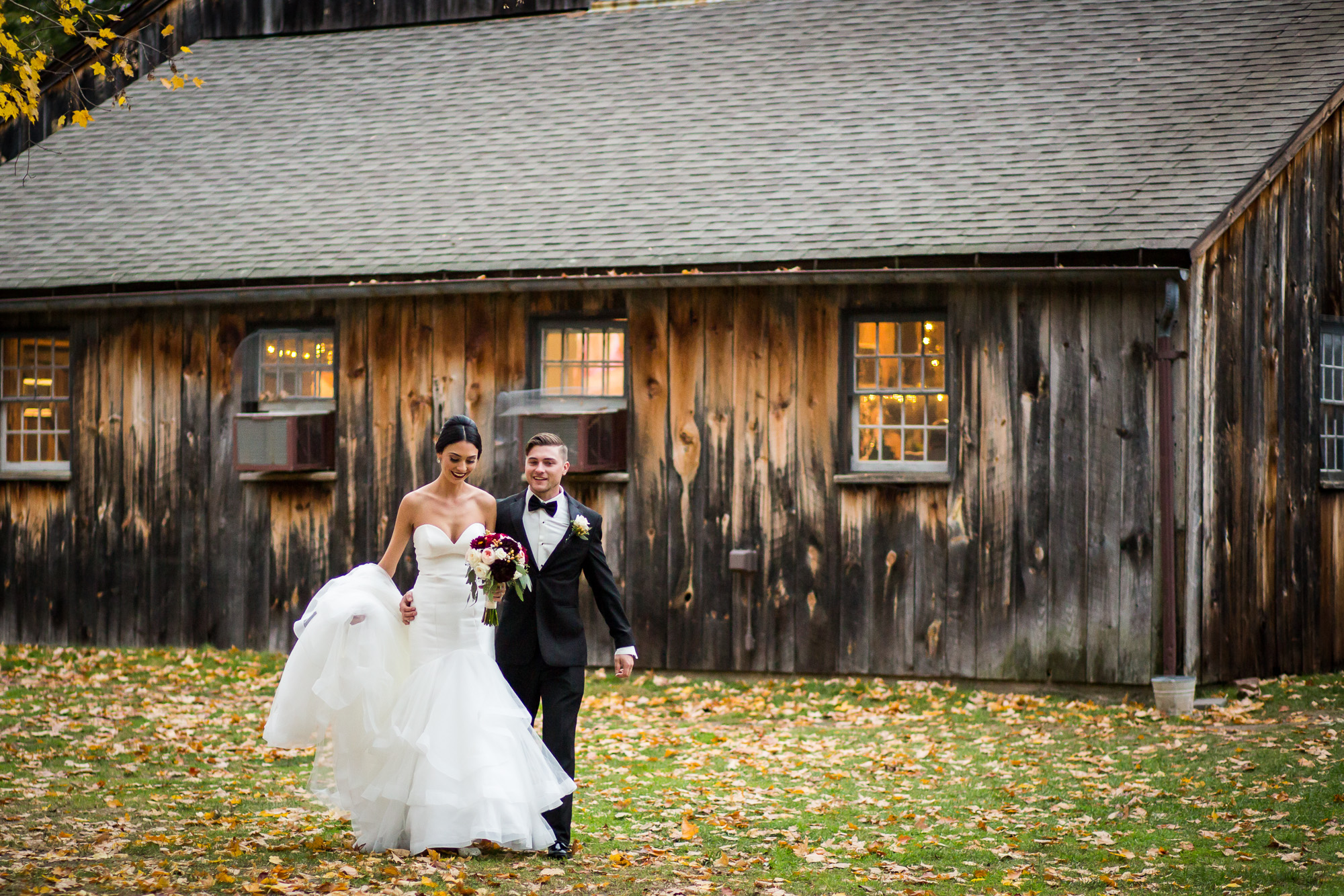 bride and groom candid at Webb Barn in Wethersfield, CT