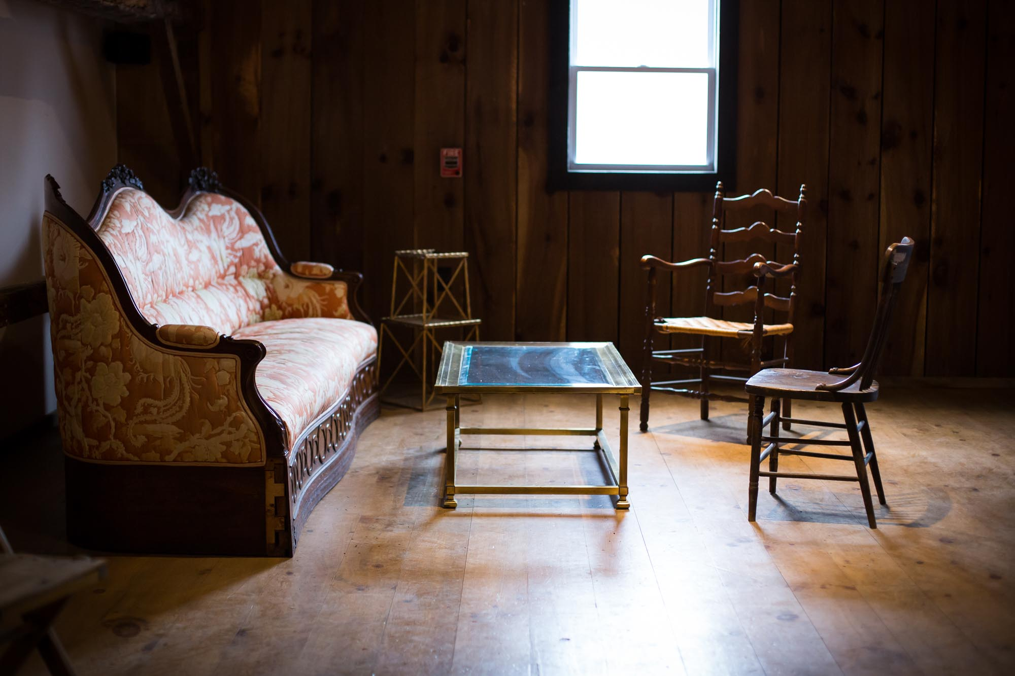 window light in a barn over vintage furniture in the loft at South Farms