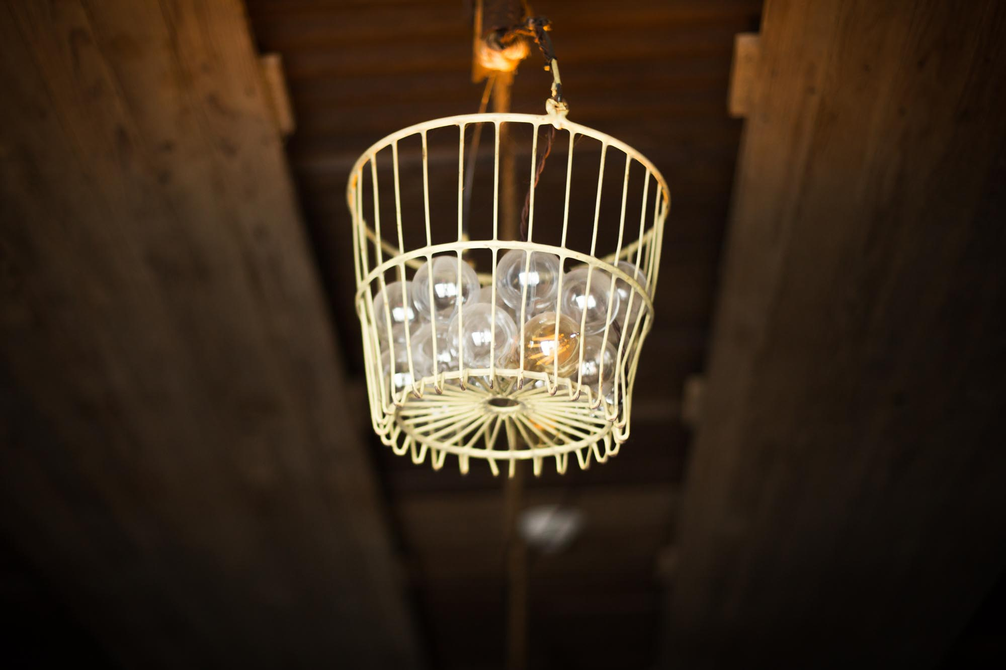 light fixture made out of egg basket and globe lights at South Farms