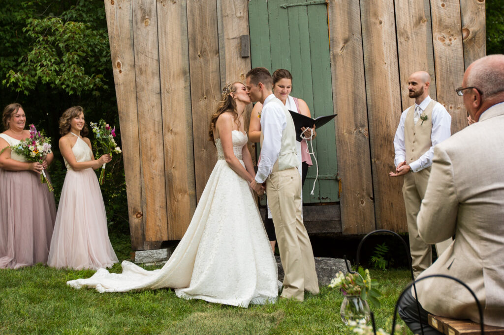 bride and groom walking down aisle at ceremony at Holliston Historical barn