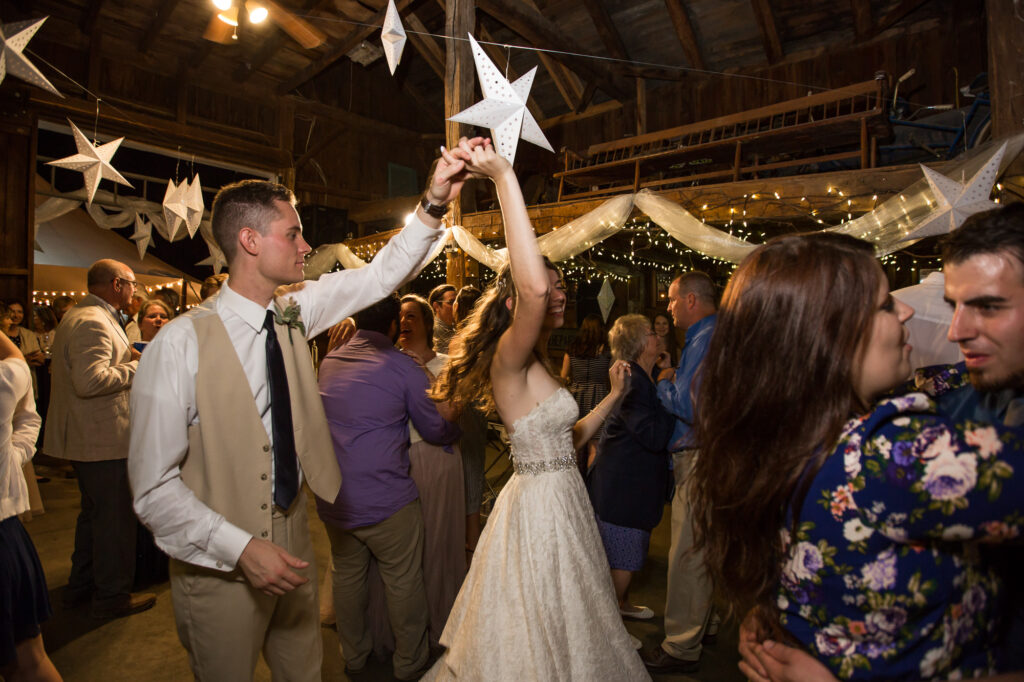 bride and groom dancing in Hollistion barn