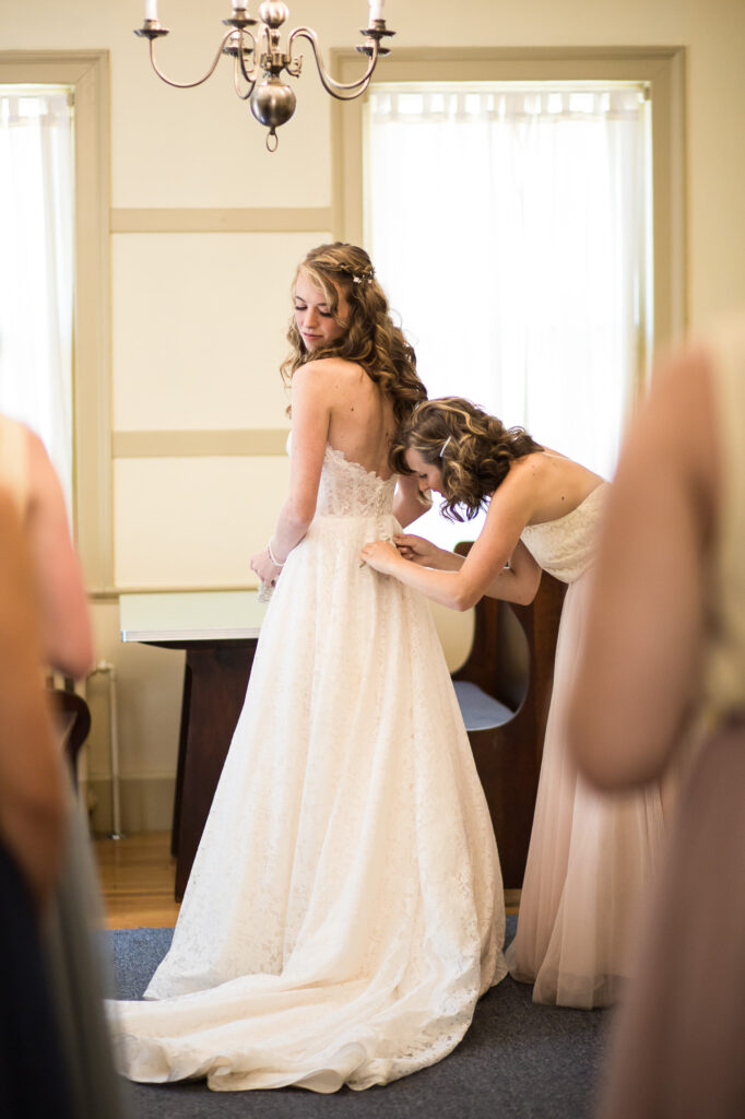 bride getting ready inside house at Holliston historical society