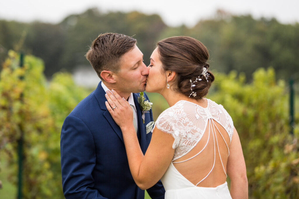 bride and groom kissing at CT winery wedding