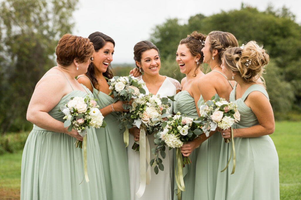 bride and bridesmaids laughing on their wedding day at CT wedding venue