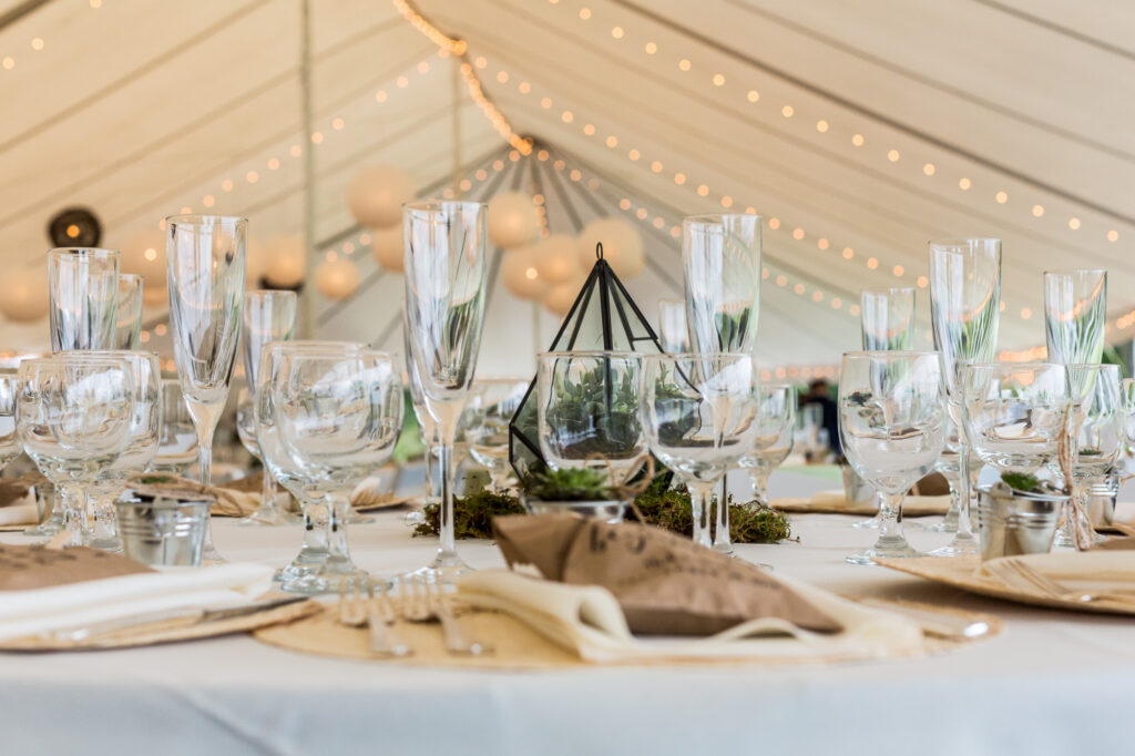 Lighting decor and wedding decorations inside tent at Priam Vineyards