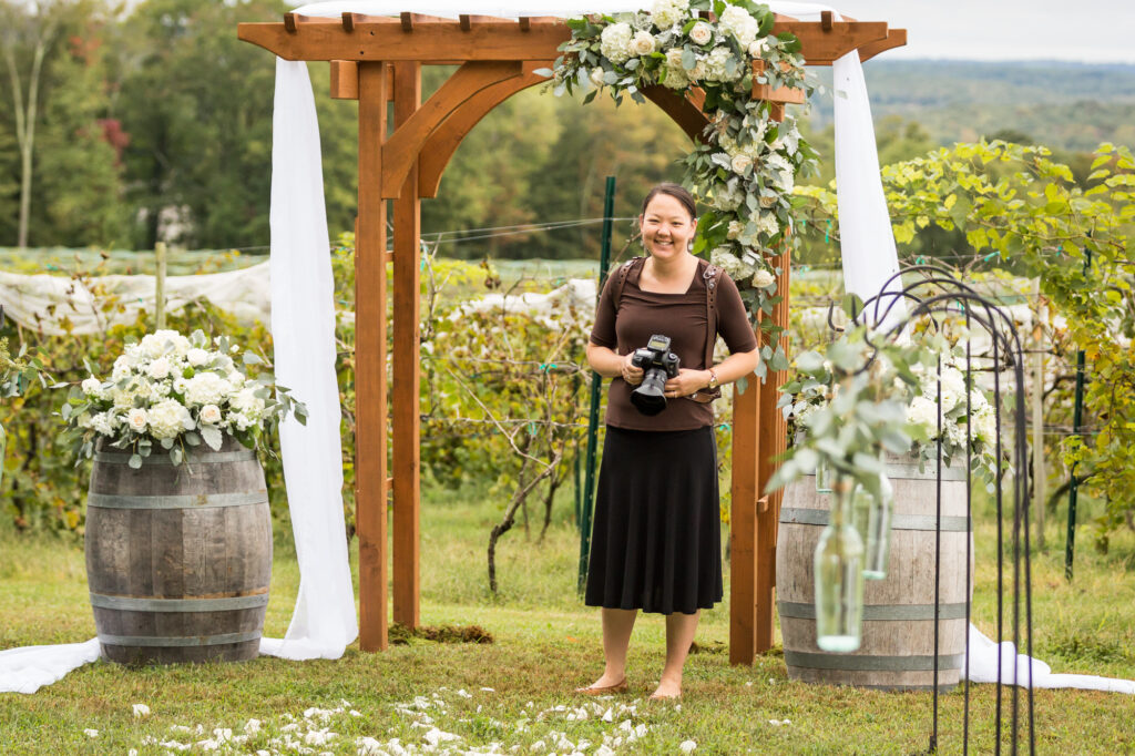 Ling Messer, owner and photographer of Trailing Twine Photography, standing at a ceremony spot