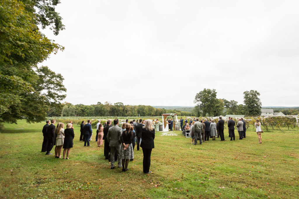 wide angle landscape of a wedding ceremony at Priam Vineyards
