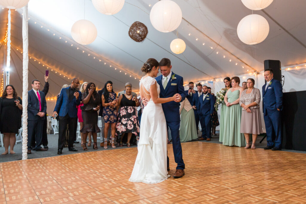 bride and groom dancing in tented wedding at Priam Vineyards