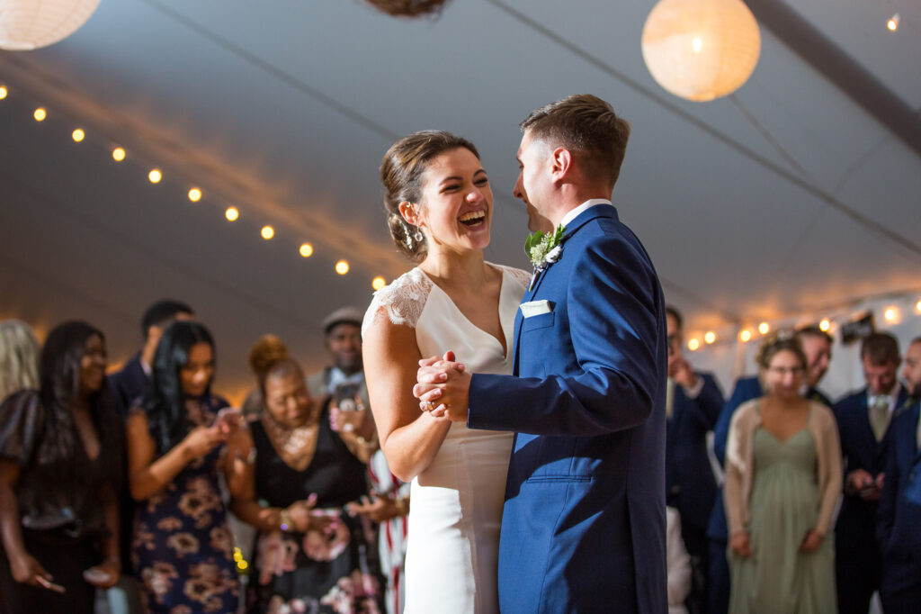 close up of bride and groom dancing their first dance in a tented wedding