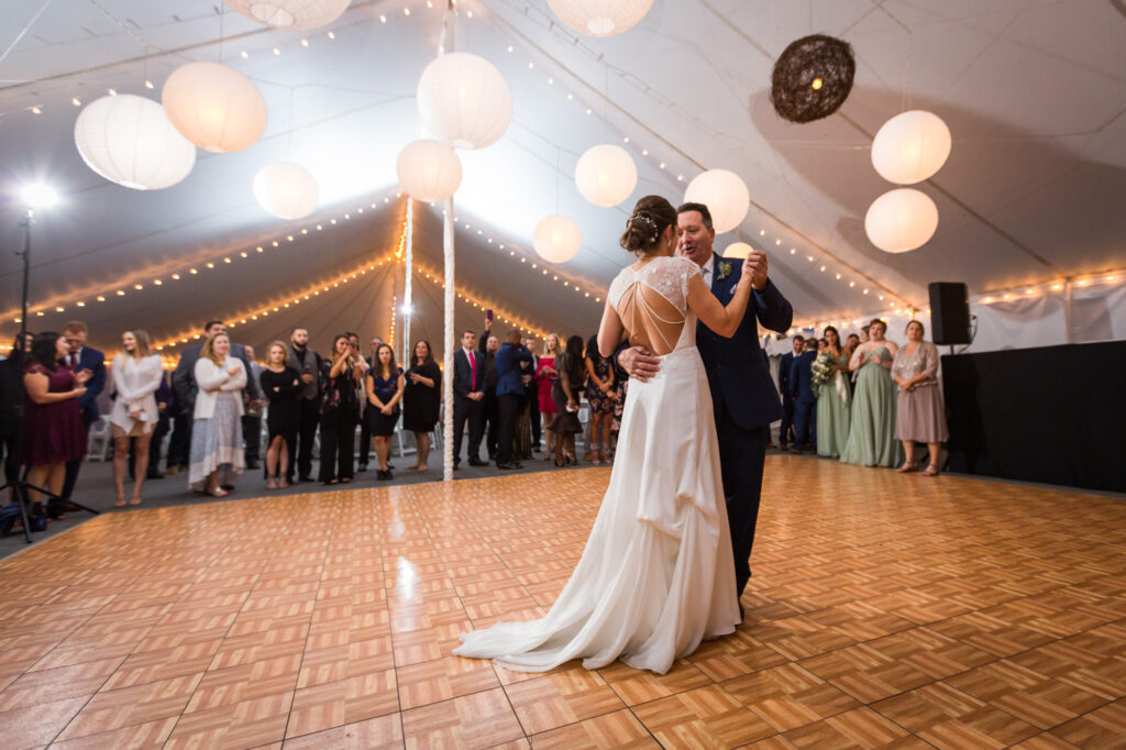 wide angle of father daughter dance in tented wedding at Priam Vineyards