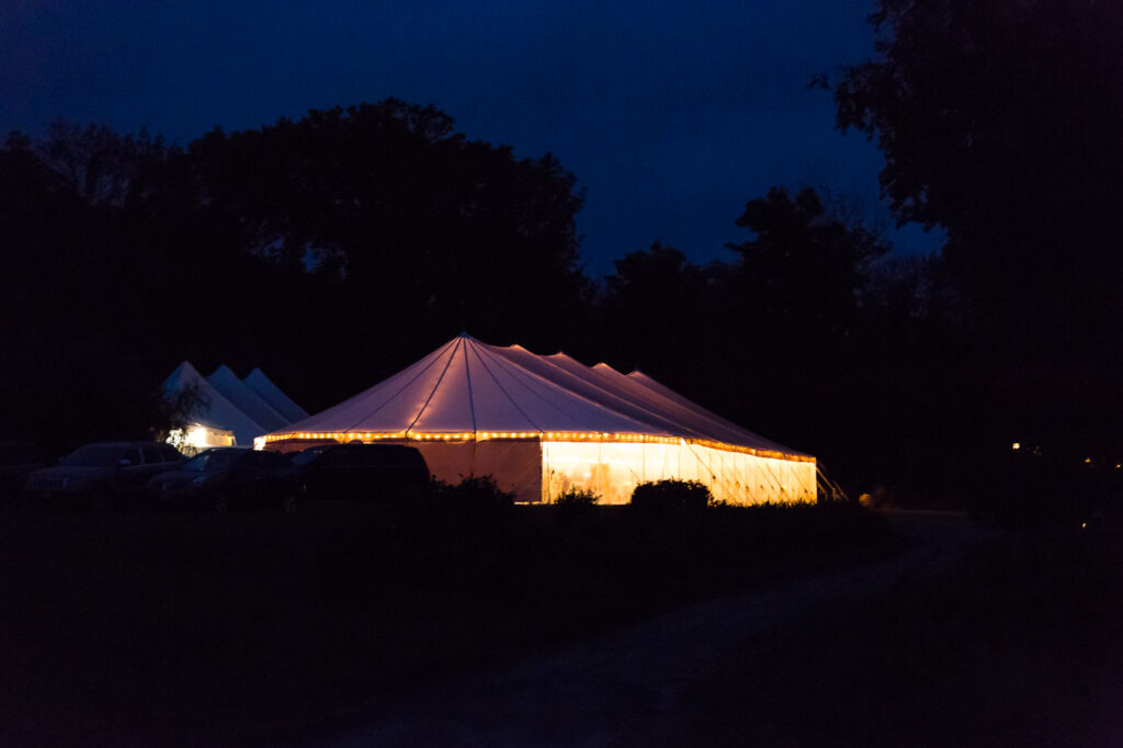 nighttime view of wedding reception tent at Priam Vineyards