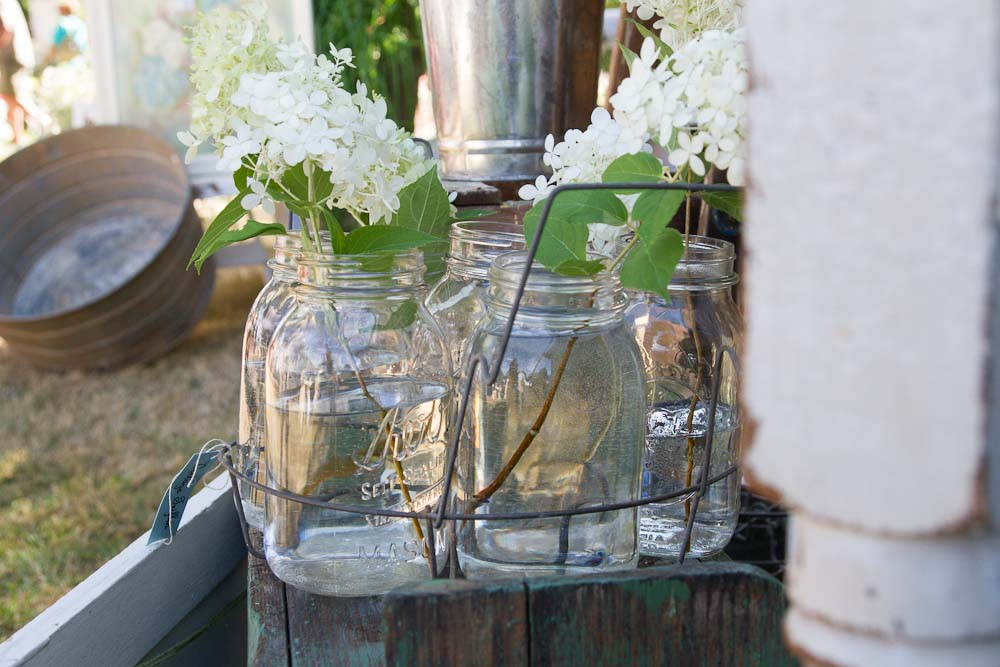 Jar lifters would be perfect to keep mason jars together with bridesmaids' flowers