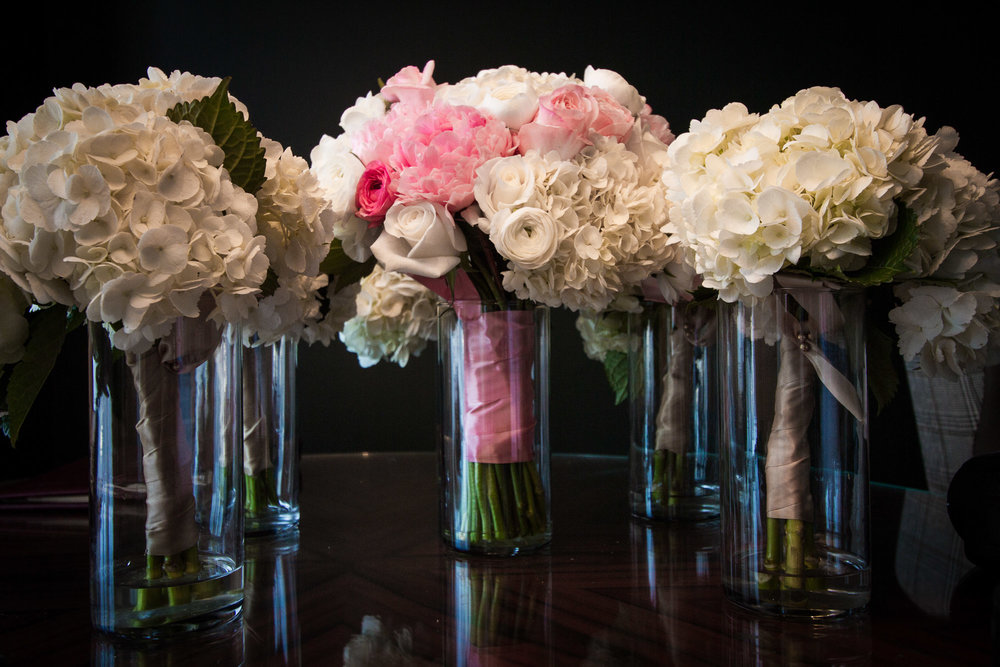 Can you tell that these gorgeous, rounded, hydrangea bouquets are suited a more serious, traditional, ballroom wedding? The bridal bouquet is mostly white hydrangea, with pink peonies, white roses, and pink and white ranunculus.