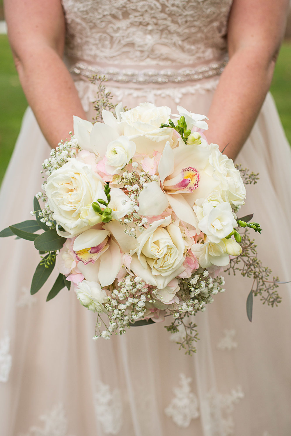 Love the touches of Baby's Breath (and Caitlin's wedding at The Barns at Wesleyan Hills!). In this pave style bouquet: Pink Hydrangea, White Polo Roses, Baby's Breath, White Cymbidium Orchids, White Ranunculus, White Freesia, Seeded Eucalyptus.