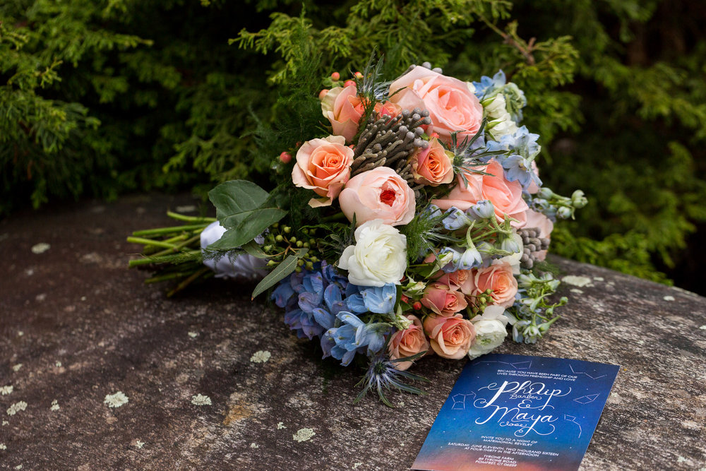 This bouquet made by Pranzi Events & Catering of Providence, RI, is full of Blue Delphinium, white Ranunculus, Thistle, Spray Roses, Garden Roses, Fern, and Flat Eucalyptus.