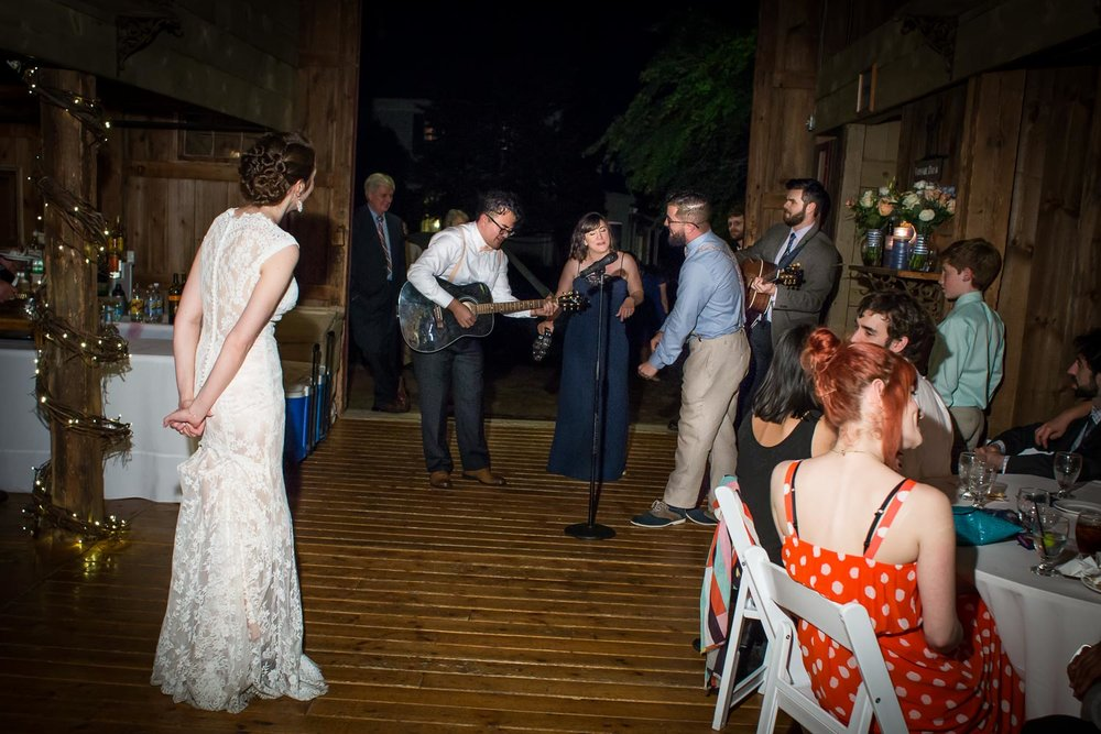 Phil's surprise serenade at the end of the night to his bride was unforgettable! The song was