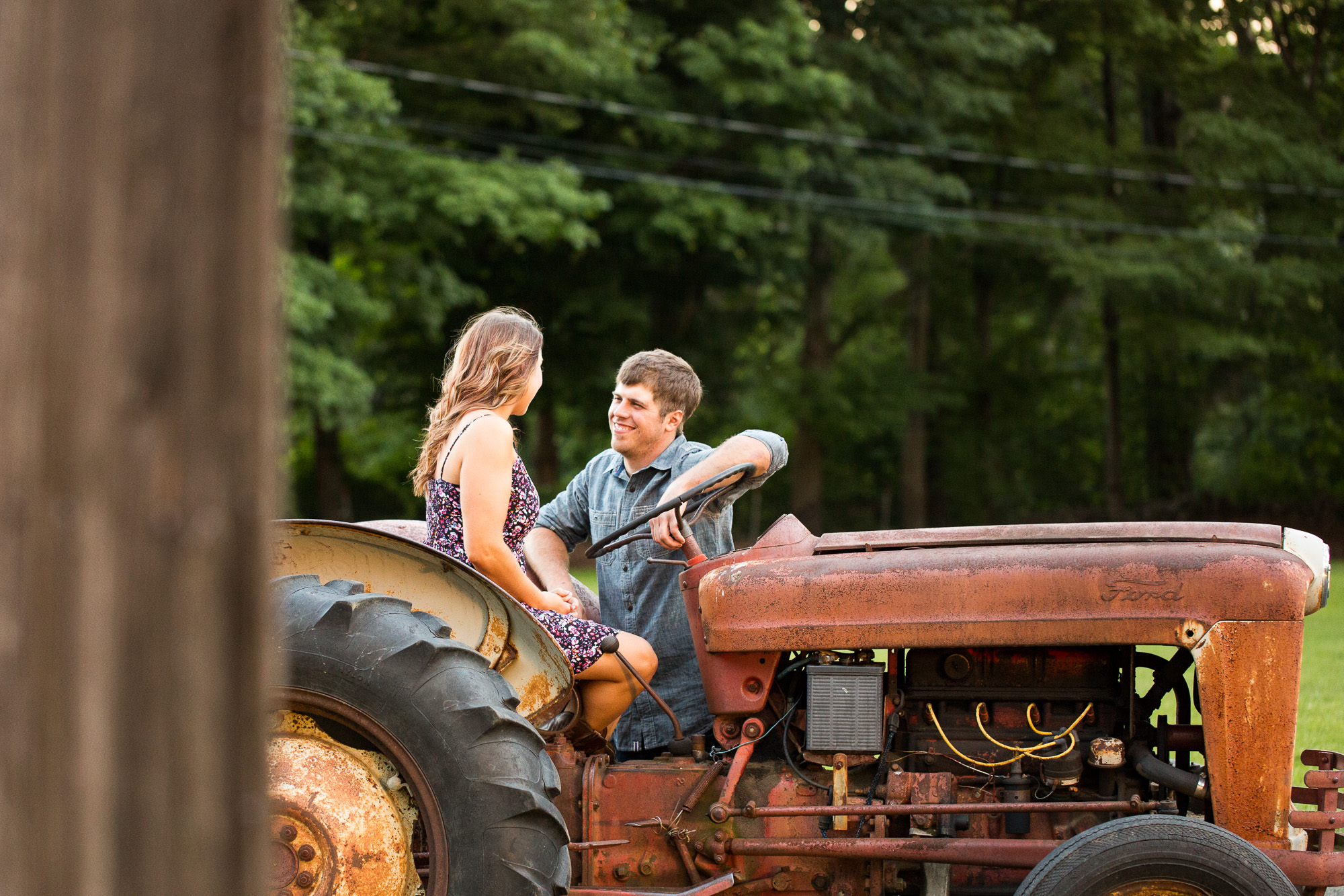 engagement session by a tractor at Bliss Farm