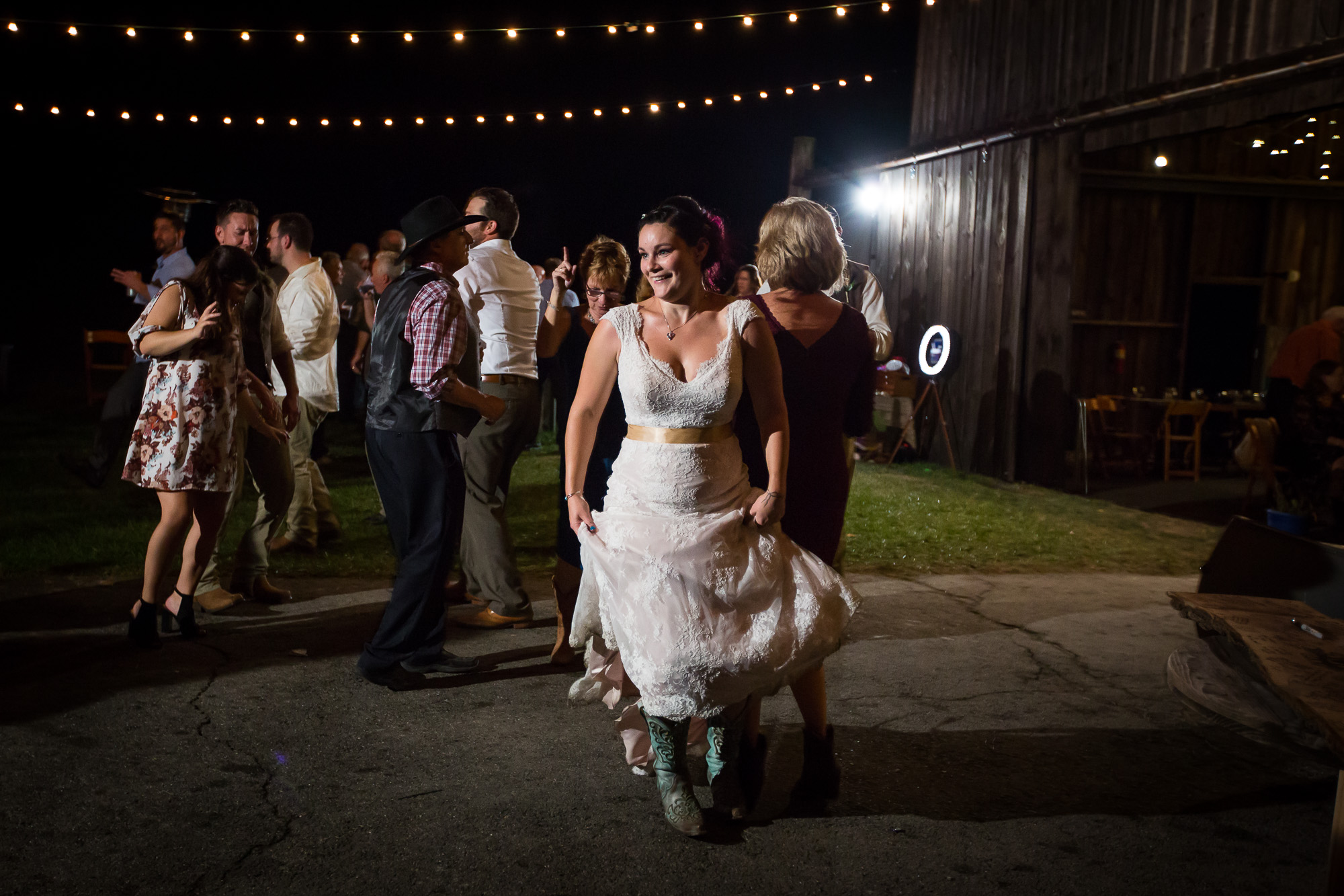 country bride dancing outside of the hangar at Candlelight Farms Inn