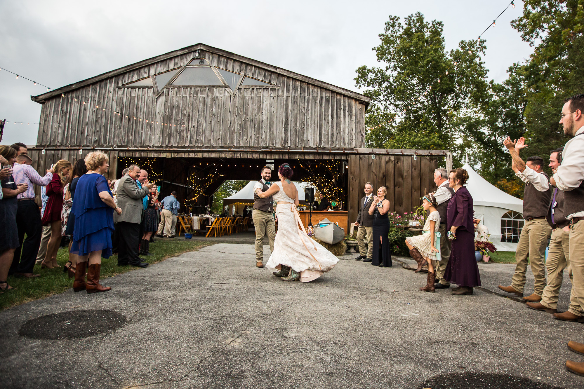 wide angle photo of first dance at Candlelight Farms Inn, outside of the hangar