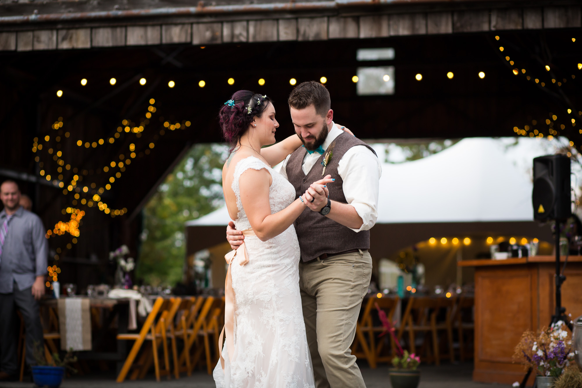 first dance on the cement pad outside of the hangar at Candlelight Farms Inn