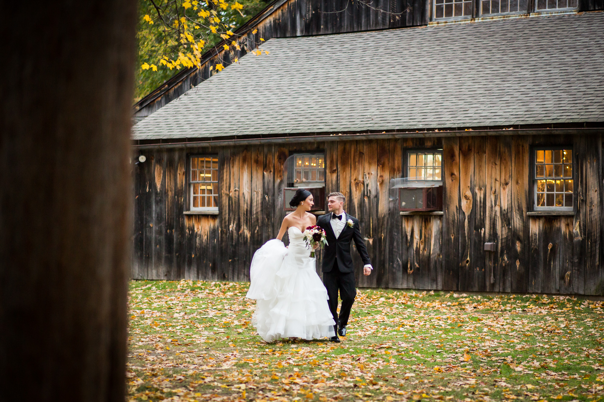 bride and groom by the Webb Barn in Wethersfield, CT