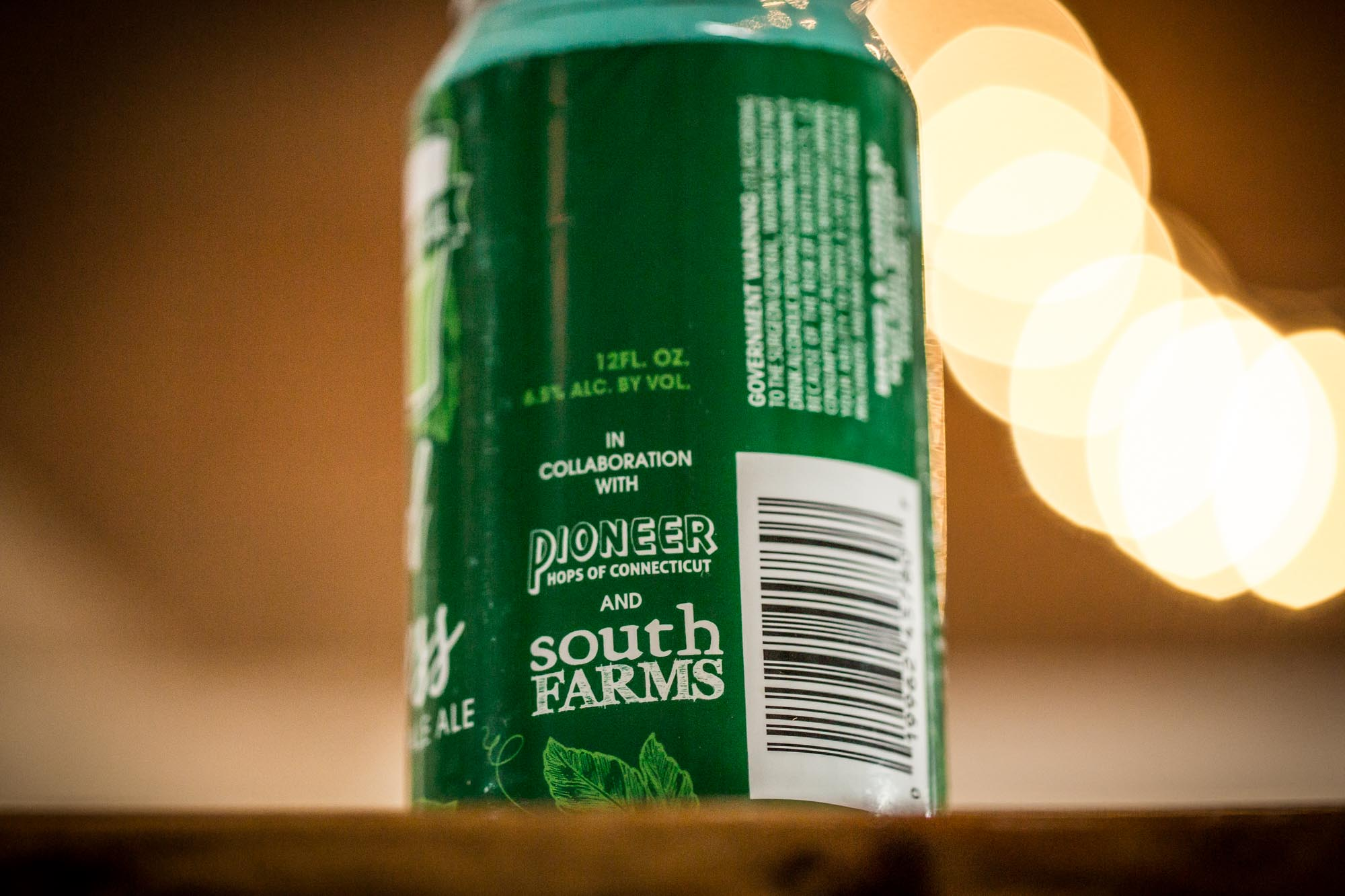 beer can with South Farms logo and Pioneer Hops