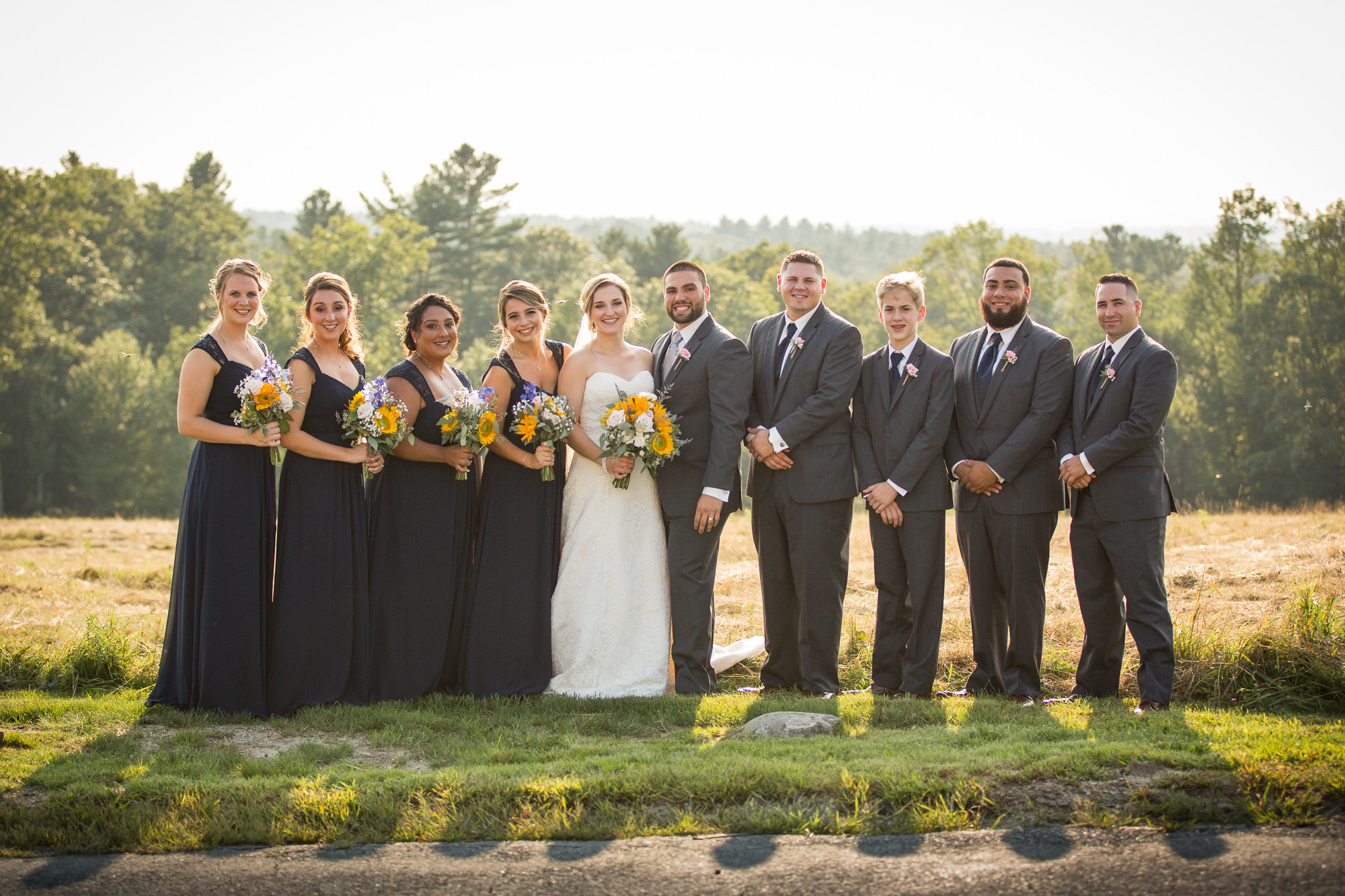 wedding party photo at Harrington Farm hay field