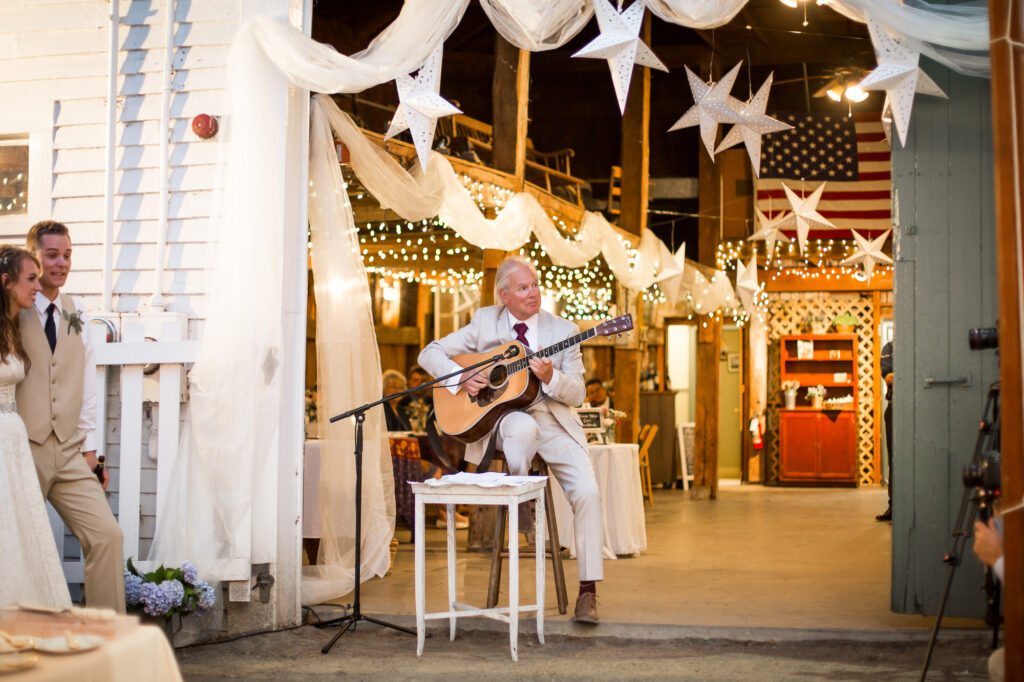 father of bride singing song and guitar