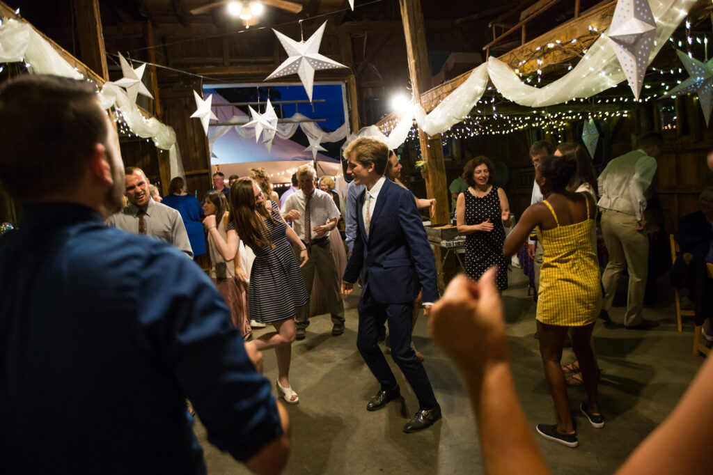 guests dancing in barn in holliston