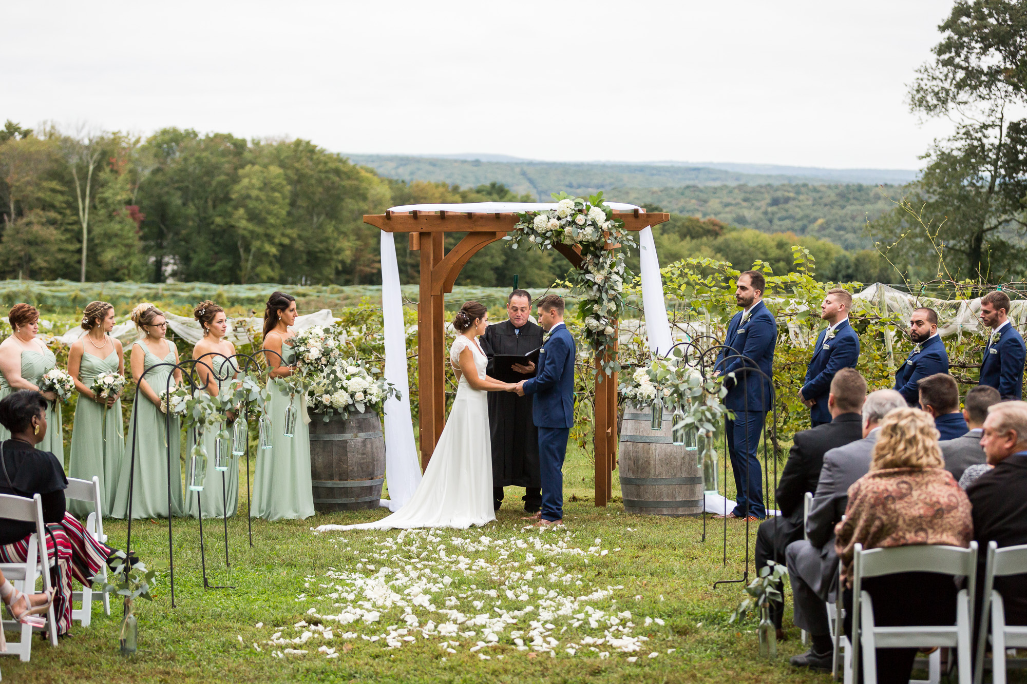 bride and groom taking their vows at an outdoor ceremony at Priam Vineyards