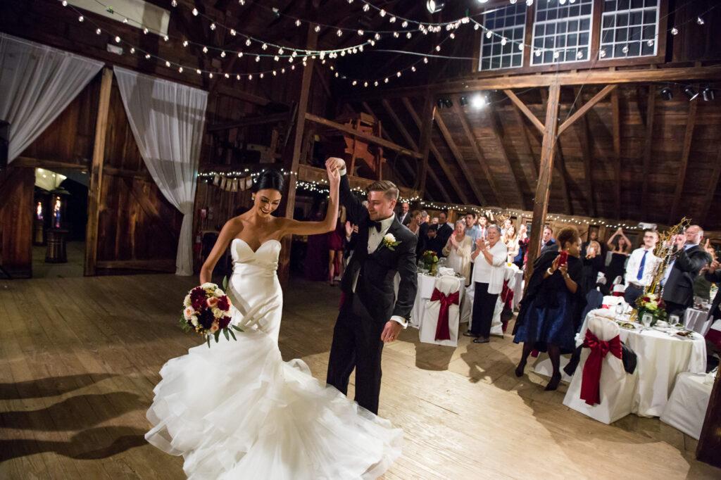 bride and groom reception entrance into Webb Barn