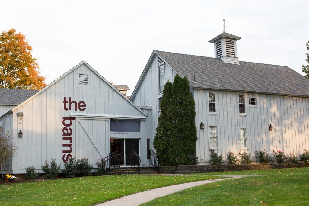 look of pale blue gray barns at wesleyan hills wedding venue